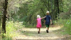 Kids walking in the woods